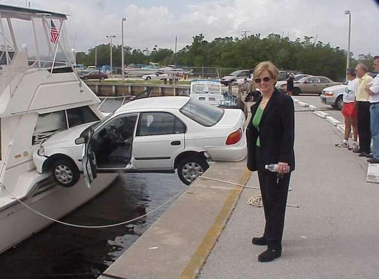 woman-crashed-car-into-boat.jpg